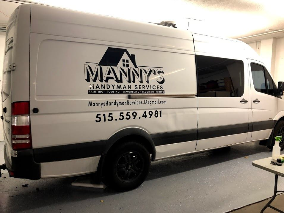 Vehicle with Manny's sign